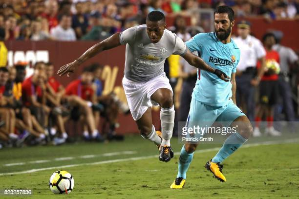 Luis Antonio Valencia of Manchester United and Arda Turan of Barcelona battle for the ball in the second half during the International Champions Cup...