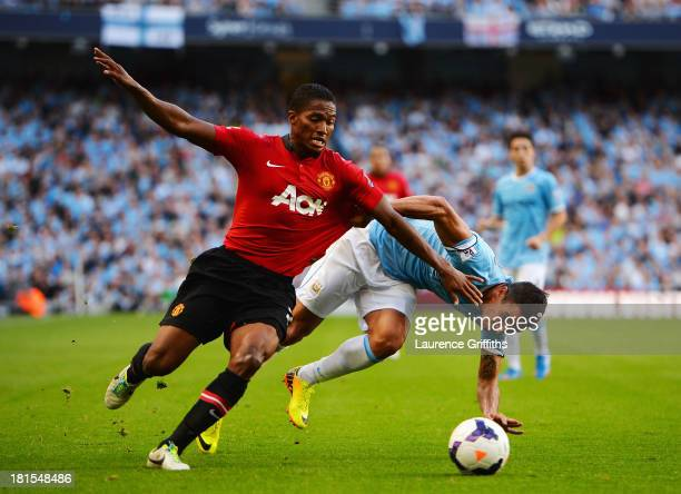 Luis Antonio Valencia of Manchester United battles with Aleksandar Kolarov of Manchester City during the Barclays Premier League match between...