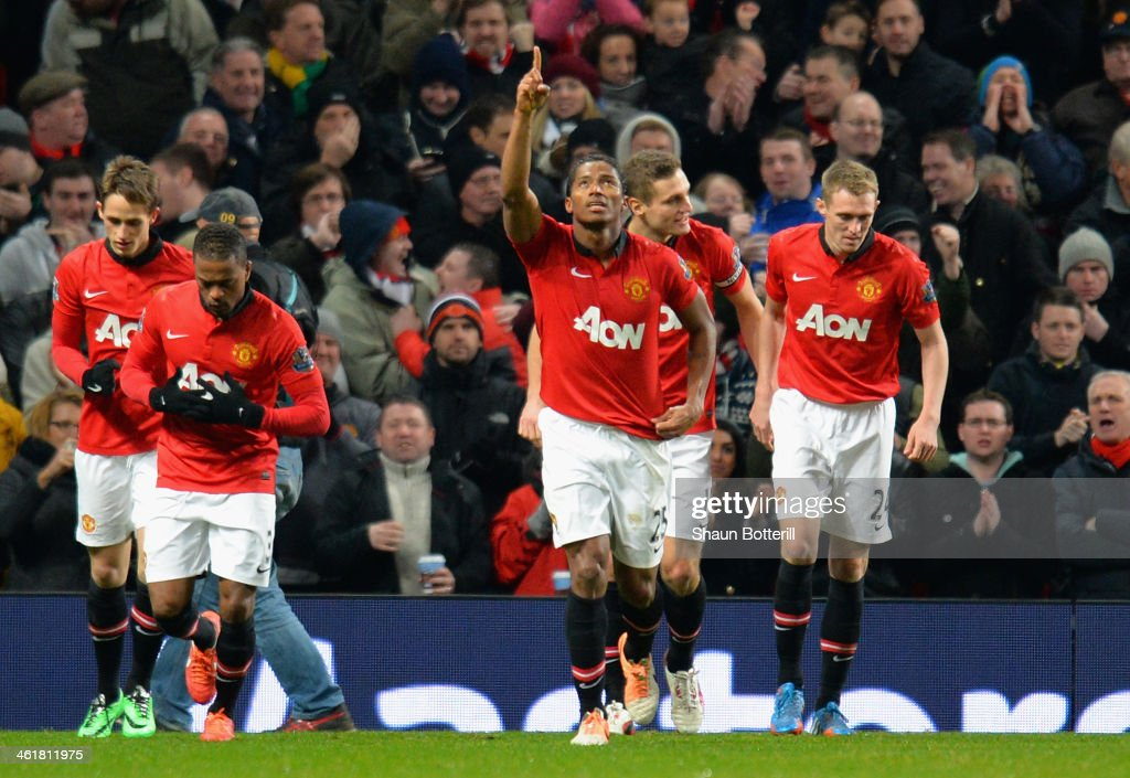 Luis <a gi-track='captionPersonalityLinkClicked' href=/galleries/search?phrase=Antonio+Valencia&family=editorial&specificpeople=543830 ng-click='$event.stopPropagation()'>Antonio Valencia</a> of Manchester United celebrates scoring the opening goal during the Barclays Premier League match between Manchester United and Swansea City at Old Trafford on January 11, 2014 in Manchester, England.