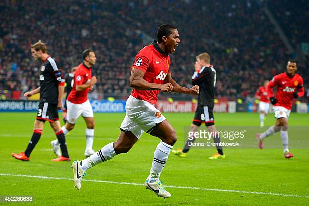 Luis Antonio Valencia of Manchester United celebrates scoring their first goal during the UEFA Champions League Group A match between Bayer...
