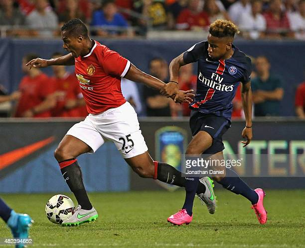 Luis Antonio Valencia of Manchester United charges up the field under pressure from Christopher Nkunku of Paris SaintGermain during a match in the...