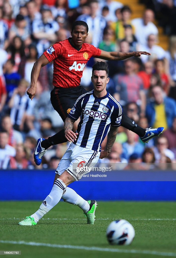 Luis Antonio Valencia of Manchester United crosses the ball past Liam Ridgewell of West Bromwich Albion for Jonas Olsson of West Bromwich Albion (not pictured) to score an own goal during the Barclays Premier League match between West Bromwich Albion and Manchester United at The Hawthorns on May 19, 2013 in West Bromwich, England.