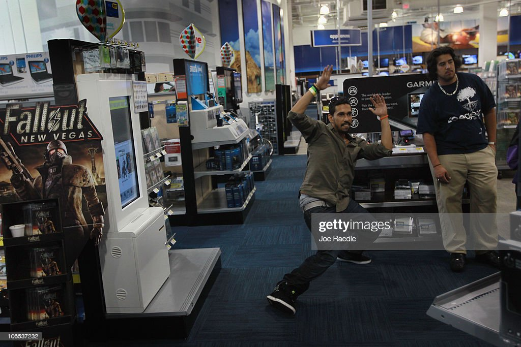 Luis Arguello plays a game with Microsoft's new Kinect controller for the Xbox 360 as Albert Ulloa looks on at the Best Buy store on November 4, 2010 in Miami Beach, Florida. The Kinect went on sale today and uses sensors to read the players body language so controllers are not necessary to play Xbox games with the Kinect.