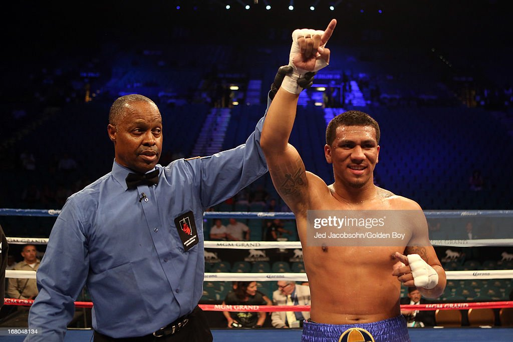 Luis Arias celebrates with referee Kenny Bayless after defeating DonYil Livingston by majority decision in their super middleweight bout at the MGM Grand Garden Arena on May 4, 2013 in Las Vegas, Nevada.