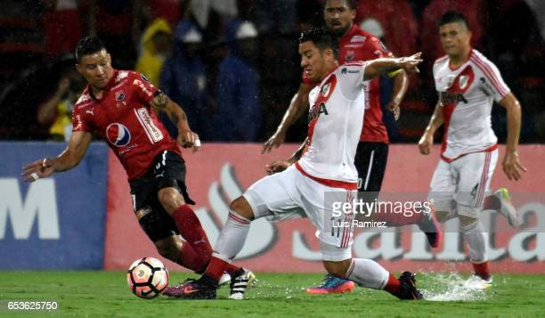 Luis Arias of Deportivo Independiente Medellin vies for the ball with Sebastian Driussi of River Plate during a group stage match between Deporivo...