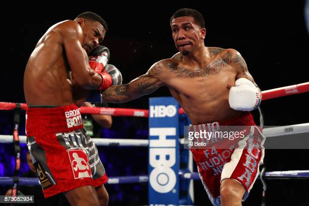 Luis Arias punches Daniel Jacobs during their Middleweight bout at Nassau Veterans Memorial Coliseum on November 11 2017 in Uniondale New York