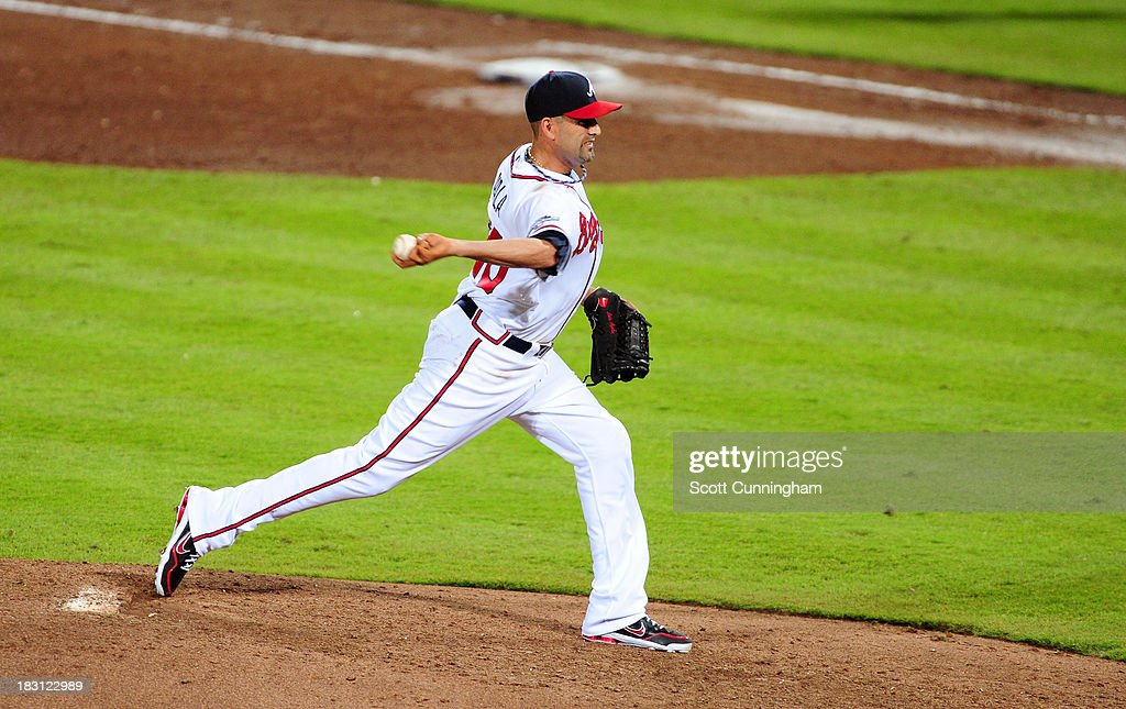 <a gi-track='captionPersonalityLinkClicked' href=/galleries/search?phrase=Luis+Ayala&family=editorial&specificpeople=209039 ng-click='$event.stopPropagation()'>Luis Ayala</a> #20 of the Atlanta Braves pitches in the seventh inning against the Los Angeles Dodgers during Game Two of the National League Division Series at Turner Field on October 4, 2013 in Atlanta, Georgia.
