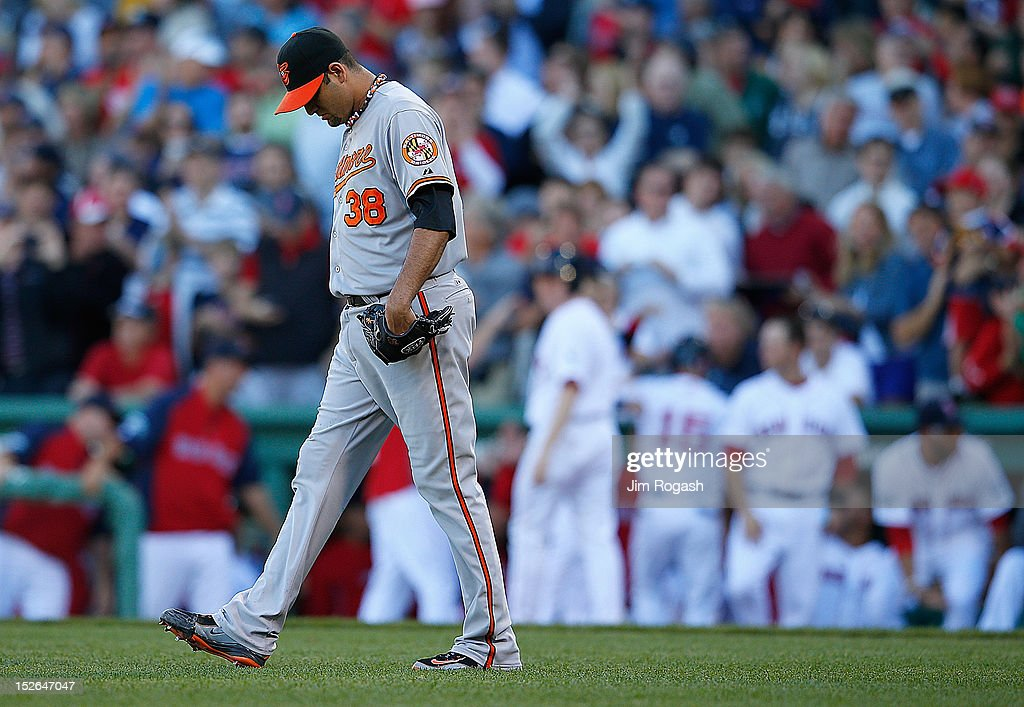 <a gi-track='captionPersonalityLinkClicked' href=/galleries/search?phrase=Luis+Ayala&family=editorial&specificpeople=209039 ng-click='$event.stopPropagation()'>Luis Ayala</a> #38 of the Baltimore Orioles reacts after he gave up a double to Cody Ross #7 of the Boston Red Sox, who knocked in the winning run, in the 8th inning at Fenway Park on September 23, 2012 in Boston, Massachusetts.