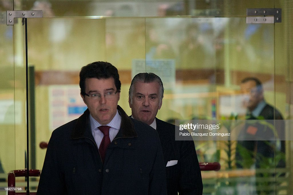 Luis Barcenas (R), former treasurer of the ruling Popular Party, and his lawyer Alfonso Trallero (L) leave the Madrid National Court after Barcenas refused to provide a statement and to undergo a calligraphic test over alleged undeclared payments made to Popular Party members on March 22, 2013 in Madrid, Spain. Barcenas is being investigated for possible fraud offenses while he was treasurer of the Popular Party.