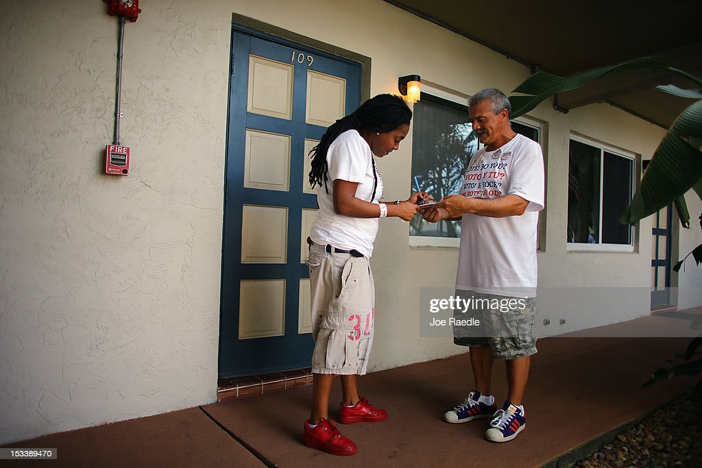Luis Battiato takes down Shanah Johnson's information as he signs her up to vote during a voter registration drive by members of the Florida...
