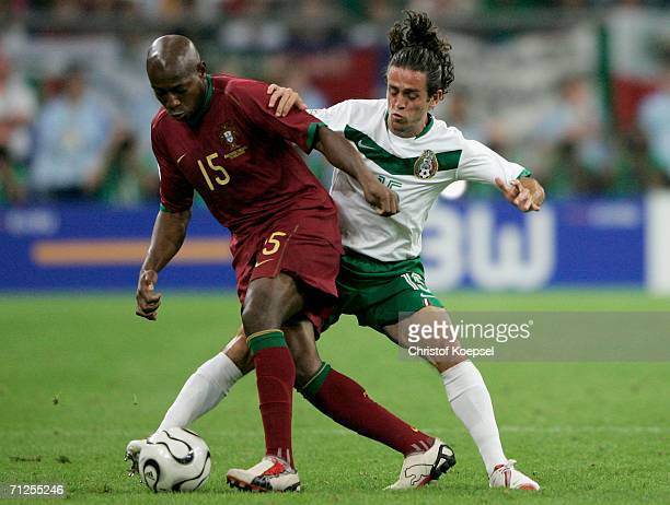 Luis Boa Morte of Portugal and Jose Antonio Castro of Mexico battle for the ball during the FIFA World Cup Germany 2006 Group D match between...
