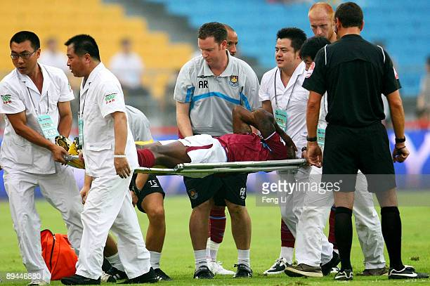Luis Boa Morte of West Ham United is stretchered off the pitch after injuring his knee during the Barclays Asia Trophy preseason friendly match...