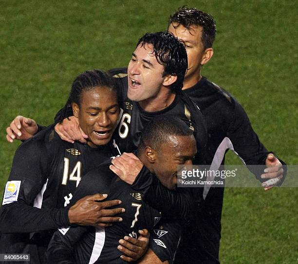 Luis Bolanos of Liga de Quito celebrates with teammates after scoring during the FIFA Club World Cup Japan 2008 semi final match between Pachuca and...