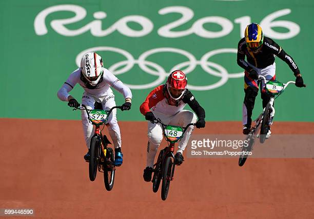R Luis Brethauer of Germany David Graf of Switzerland Carlos Mario Oquendo Zabala of Colombia during the Men's BMX Semifinal on day 14 of the Rio...