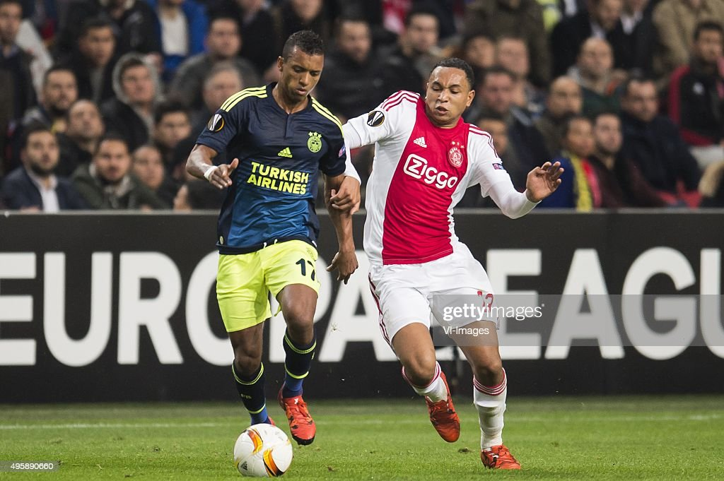 Luis Carlos Almeida da Cunha (Nani) of Fenerbahce, Kenny Tete of Ajax during the UEFA Europa League match between Ajax and Fenerbahce on November 5, 2015 at the Amsterdam Arena in Amsterdam, The Netherlands.