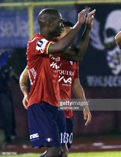 Luis Carlos Cabezas of Bolivia's Wilstermann celebrates with teammates after scoring against Atletico Tucuman of Argentina during their Copa...