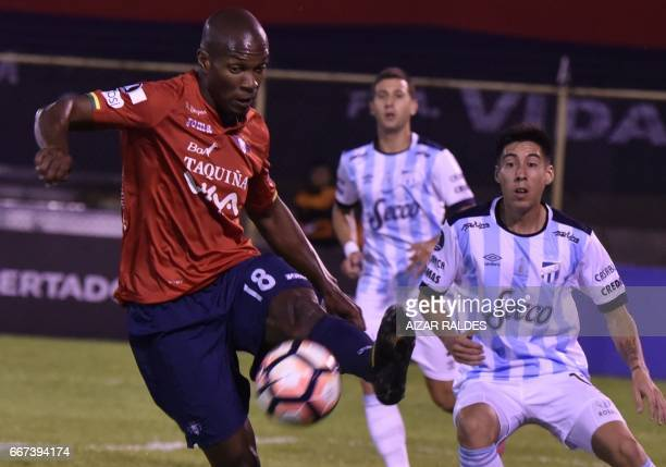 Luis Carlos Cabezas of Bolivia's Wilstermann vies for the ball with Pablo Mauricio Rosales Atletico Tucuman of Argentina during their Copa...