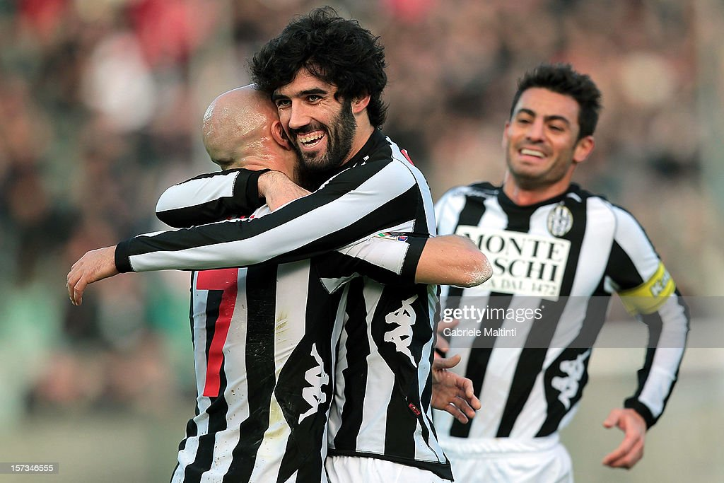 Luis Carlos Novo Neto (C) of AC Siena celebrates with team-mates after scoring athe opening goal of the Serie A match between AC Siena and AS Roma at Stadio Artemio Franchi on December 2, 2012 in Siena, Italy.