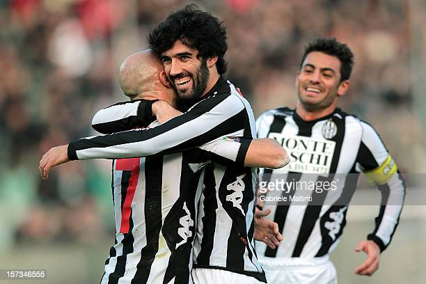 Luis Carlos Novo Neto of AC Siena celebrates with teammates after scoring athe opening goal of the Serie A match between AC Siena and AS Roma at...