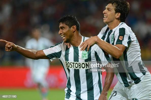 Luis Carlos Ruiz of Atletico Nacional celebrates with his teammates after scoring the first goal of his team during a match between Atletico Medellin...
