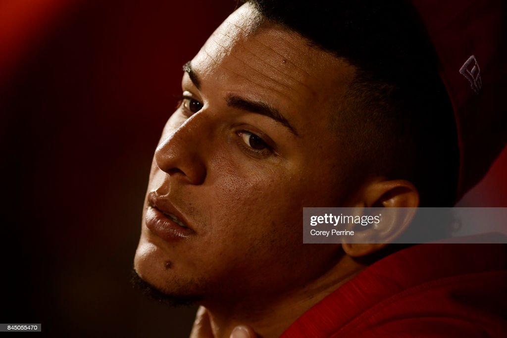 Luis Castillo #58 of the Cincinnati Reds looks on from the dugout during the second inning against the New York Mets at Citi Field on September 9, 2017 in the Flushing neighborhood of the Queens borough of New York City.