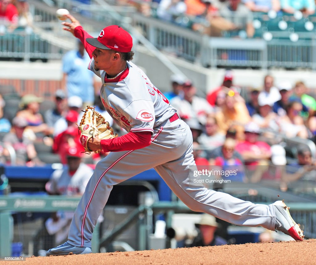 Luis Castillo #58 of the Cincinnati Reds throws a first inning pitch against the Atlanta Braves at SunTrust Park on August 20, 2017 in Atlanta, Georgia.
