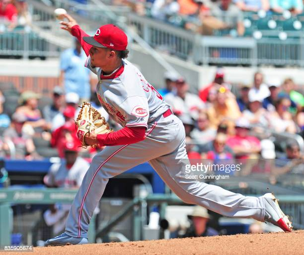 Luis Castillo of the Cincinnati Reds throws a first inning pitch against the Atlanta Braves at SunTrust Park on August 20 2017 in Atlanta Georgia