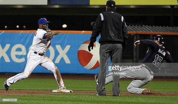 Luis Castillo of the New York Mets throws to first base to complete a fifth inning ending double play after forcing out Brian McCann of the Atlanta...