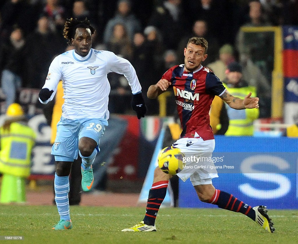 Luis Cavanda (L) of SS Lazio competes for the ball with <a gi-track='captionPersonalityLinkClicked' href=/galleries/search?phrase=Tiberio+Guarente&family=editorial&specificpeople=4667653 ng-click='$event.stopPropagation()'>Tiberio Guarente</a> of Bologna FC during the Serie A match between Bologna FC and S.S. Lazio at Stadio Renato Dall'Ara on December 10, 2012 in Bologna, Italy.