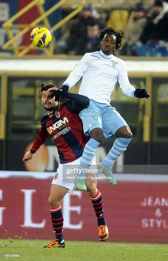 Luis Cavanda # 39 of SS Lazio ( R ) competes the ball with Panagiotis Kone # 33 of Bologna FC ( L ) during the Serie A match between Bologna FC and S.S. Lazio at Stadio Renato Dall'Ara on December 10, 2012 in Bologna, Italy.