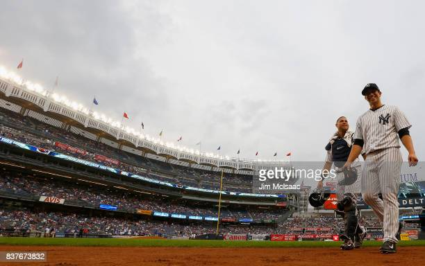 Luis Cessa and Gary Sanchez of the New York Yankees in action against the New York Mets at Yankee Stadium on August 14 2017 in the Bronx borough of...