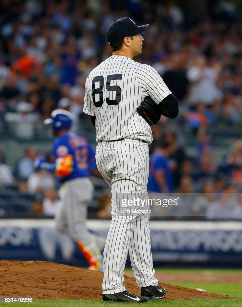 Luis Cessa of the New York Yankees looks on after surrendering a third inning home run to Yoenis Cespedes of the New York Mets at Yankee Stadium on...