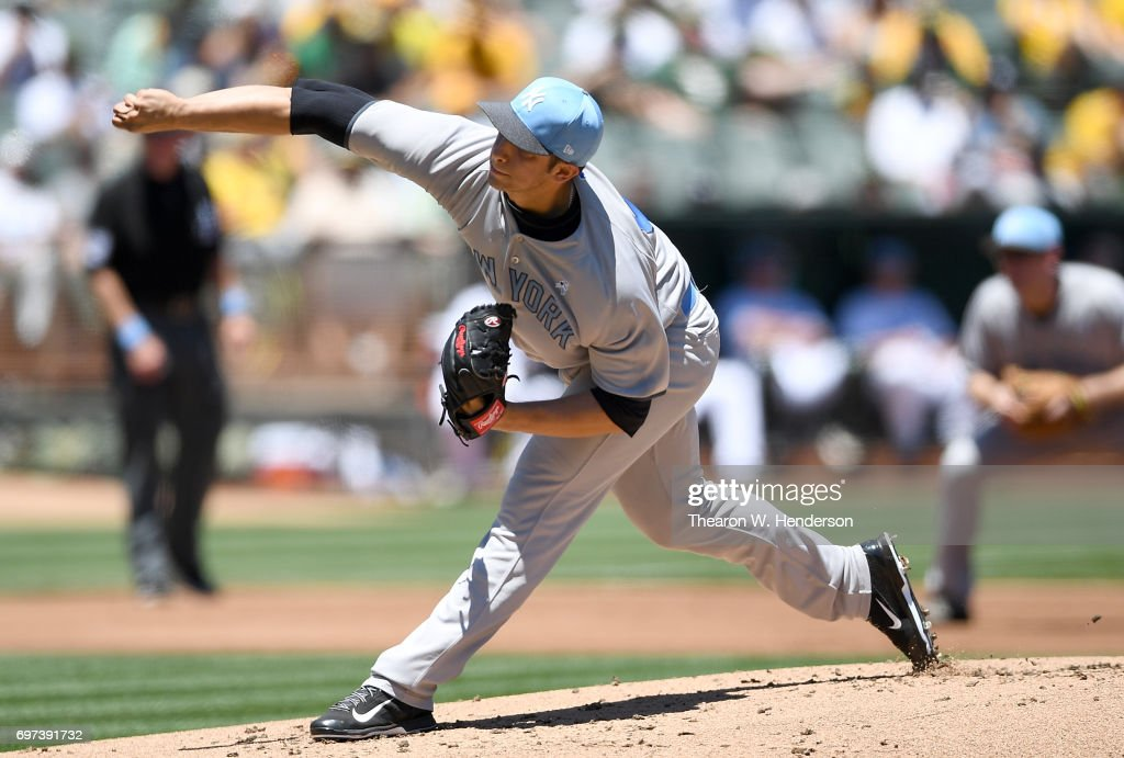 Luis Cessa #85 of the New York Yankees pitches against the Oakland Athletics in the bottom of the first inning at Oakland Alameda Coliseum on June 18, 2017 in Oakland, California.