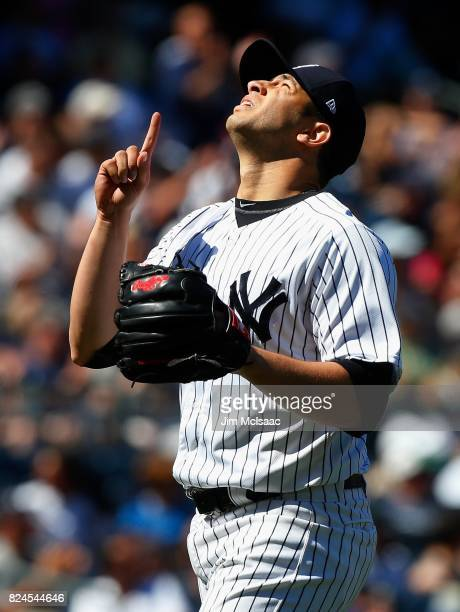 Luis Cessa of the New York Yankees walks to the dugout after the sixth inning against the Tampa Bay Rays at Yankee Stadium on July 30 2017 in the...