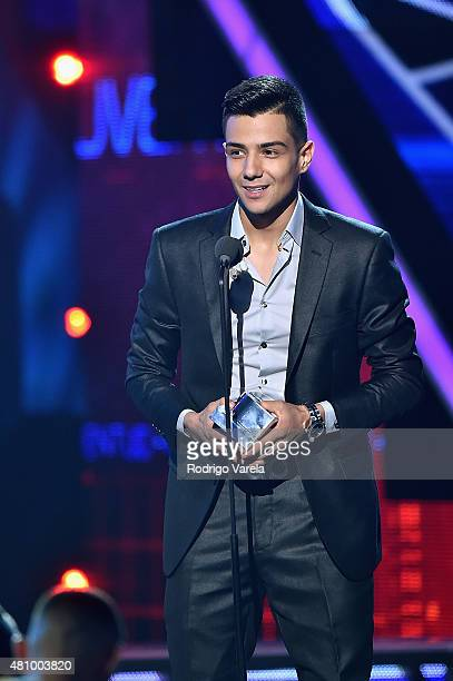 Luis Coronel accepts an award onstage at Univision's Premios Juventud 2015 at Bank United Center on July 16 2015 in Miami Florida
