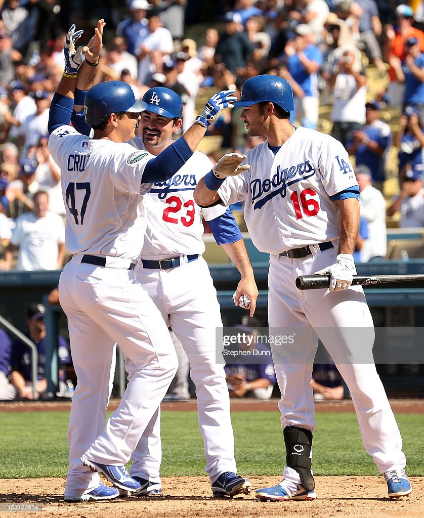 Luis Cruz #47 of the Los Angeles Dodgers celebrates with Adrian Gonzalez #23 and <a gi-track='captionPersonalityLinkClicked' href=/galleries/search?phrase=Andre+Ethier&family=editorial&specificpeople=543213 ng-click='$event.stopPropagation()'>Andre Ethier</a> as he scores on his two run home run in the fourth inning against the Colorado Rockies on September 30, 2012 at Dodger Stadium in Los Angeles, California.