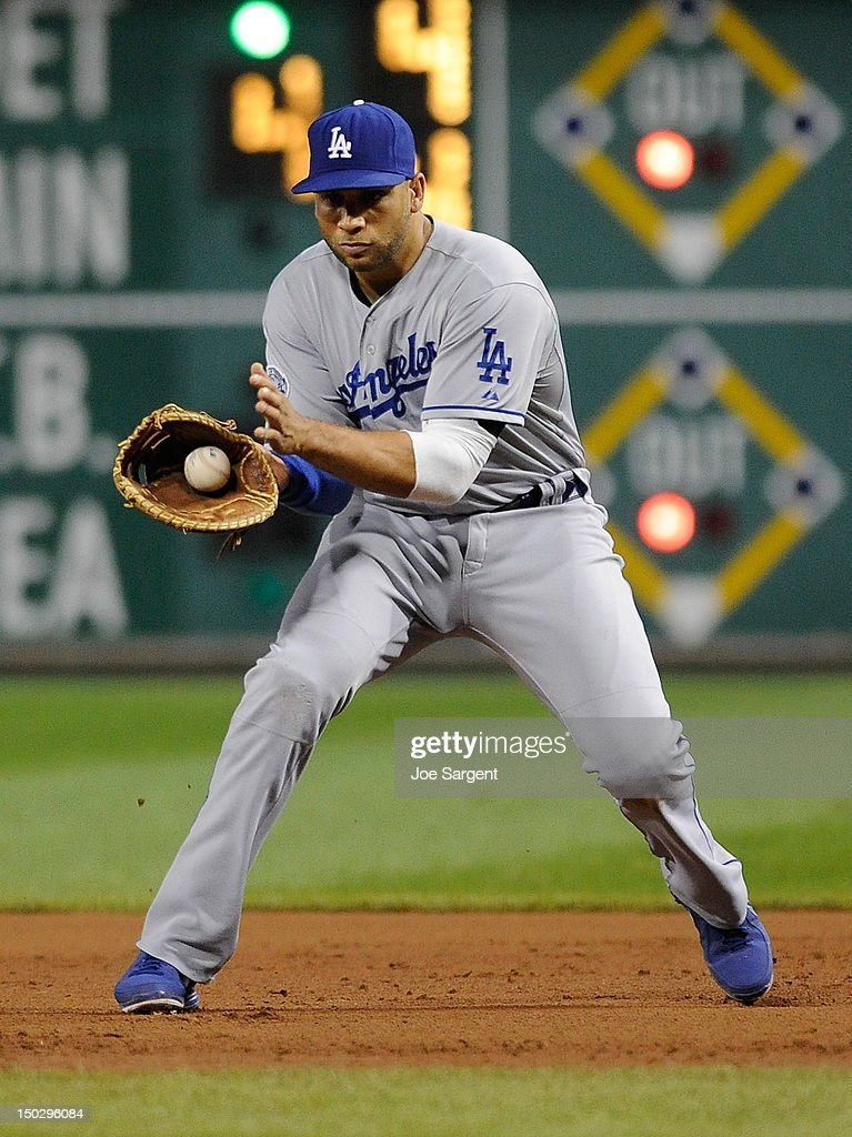 Luis Cruz #47 of the Los Angeles Dodgers fields a ground ball during the game against the Pittsburgh Pirates on August 14, 2012 at PNC Park in Pittsburgh, Pennsylvania. Los Angeles won the game 11-0.