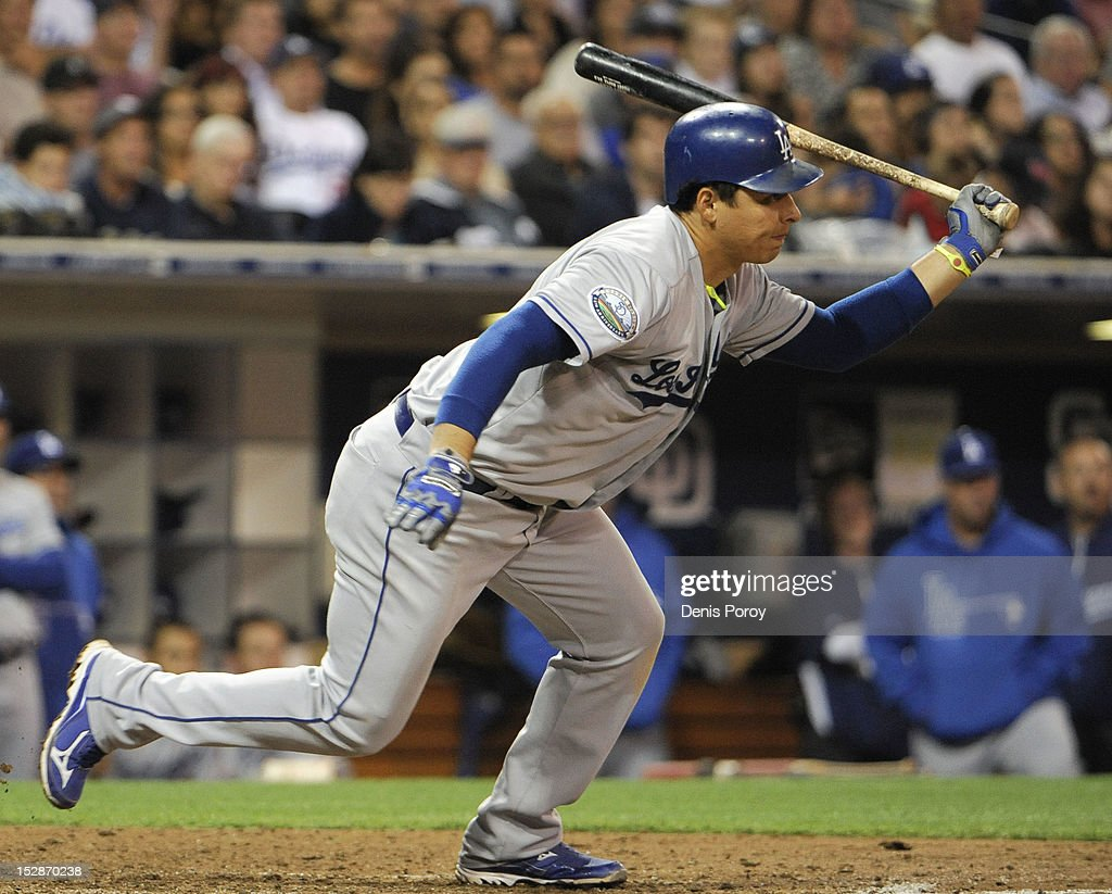 Luis Cruz #47 of the Los Angeles Dodgers hits a two-RBI single during the fifth inning of a baseball game against the San Diego Padres at Petco Park on September 27, 2012 in San Diego, California.