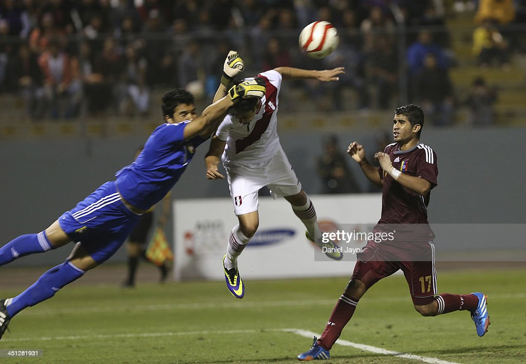 Luis Da Silva, of Peru, (C) Emmis Rodriguez, of Venezuela, (L) and Francisco Diaz, of Venezuela, compete in soccer U18 event as part of the XVII Bolivarian Games Trujillo 2013 at Mansiche Stadium on November 21, 2013 in Lima, Peru.