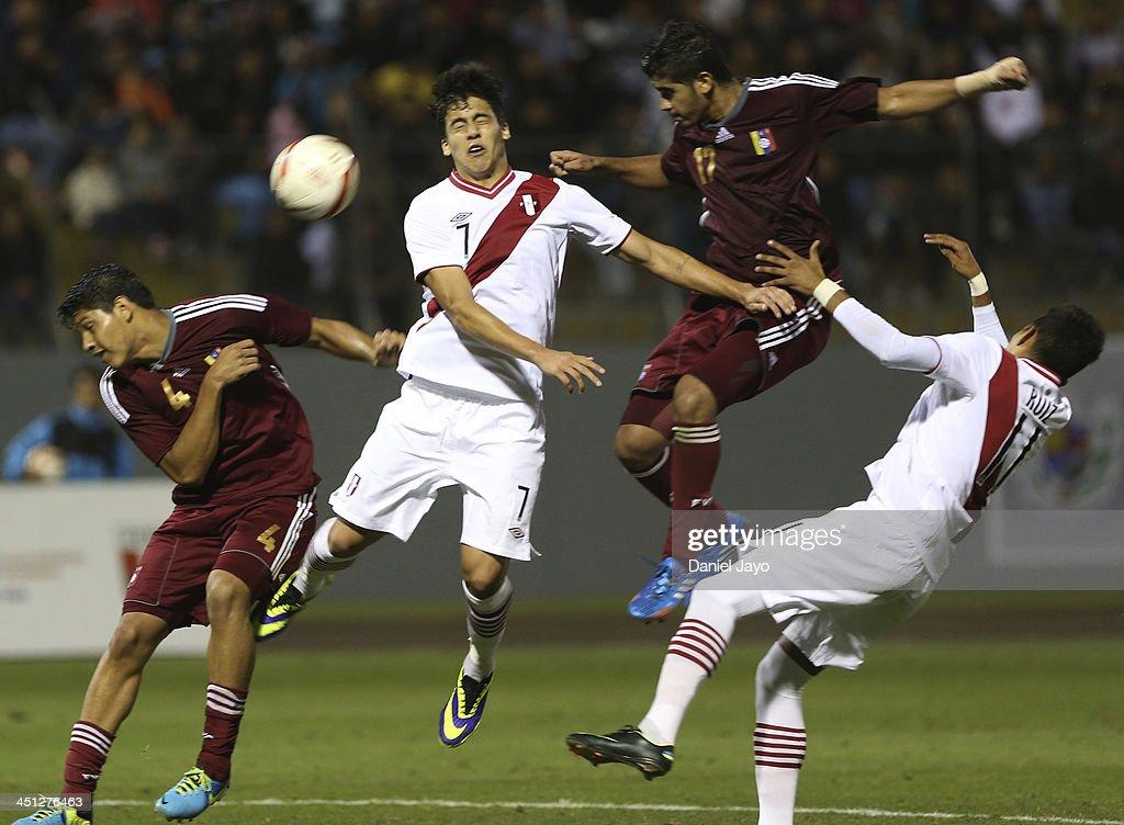 Luis Da Silva of Peru (second from left) Jose Po of Venezuela, (L) Francisco Diaz, of Venezuela, and Kevin Ruiz, of Peru, (R compete in soccer U18 event as part of the XVII Bolivarian Games Trujillo 2013 at Mansiche Stadium on November 21, 2013 in Lima, Peru.