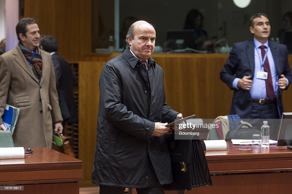<a gi-track='captionPersonalityLinkClicked' href=/galleries/search?phrase=Luis+de+Guindos&family=editorial&specificpeople=8756055 ng-click='$event.stopPropagation()'>Luis de Guindos</a>, Spain's economy minister, arrives for a meeting of European Union (EU) finance ministers at the European Council headquarters in Brussels, Belgium, on Tuesday, Dec. 4, 2012. European finance ministers voiced confidence that Greece will pull off a successful bond buyback, the key element in a revamped effort to stem the debt crisis in the country where it started. Photographer: Jock Fistick/Bloomberg via Getty Images