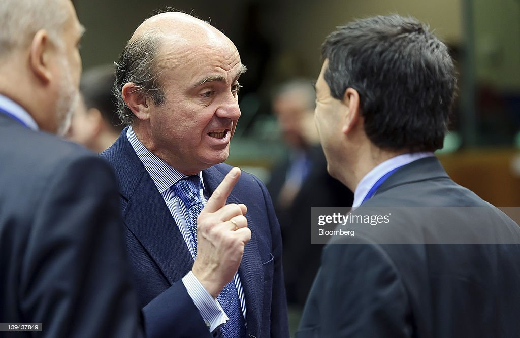 Luis de Guindos Spain's economy minister center gestures whilst speaking with Vitor Gaspar Portugal's finance minister right ahead of a European...
