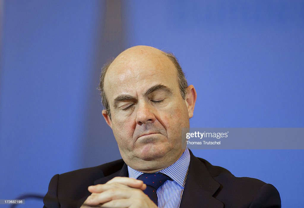 <a gi-track='captionPersonalityLinkClicked' href=/galleries/search?phrase=Luis+de+Guindos&family=editorial&specificpeople=8756055 ng-click='$event.stopPropagation()'>Luis de Guindos</a>, Spain's economy minister is pictured during a press conference on July 04, 2013 in Berlin, Germany. German Finance Minister Wolfgang Schaeuble and Spanish Economy Mister <a gi-track='captionPersonalityLinkClicked' href=/galleries/search?phrase=Luis+de+Guindos&family=editorial&specificpeople=8756055 ng-click='$event.stopPropagation()'>Luis de Guindos</a> sign a loan which is the heart of a German Spanish investment programme aimed to promote Spanish small and medium-sized enterprises.