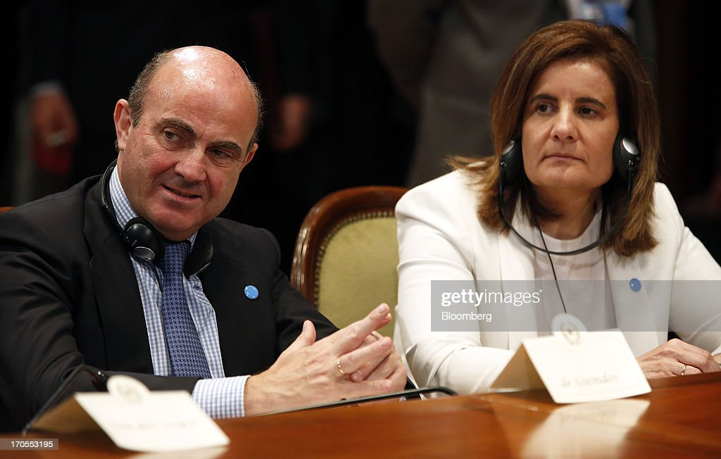 <a gi-track='captionPersonalityLinkClicked' href=/galleries/search?phrase=Luis+de+Guindos&family=editorial&specificpeople=8756055 ng-click='$event.stopPropagation()'>Luis de Guindos</a>, Spain's economy minister, left, and <a gi-track='captionPersonalityLinkClicked' href=/galleries/search?phrase=Fatima+Banez&family=editorial&specificpeople=8764943 ng-click='$event.stopPropagation()'>Fatima Banez</a>, Spain's labor minister, listen during a news conference following a youth unemployment summit at Chigi palace in Rome, Italy, on Friday, June 14, 2013. The euro-region's unemployment rate climbed to a record 12.2 percent in April, the European Union statistics office in Luxembourg said on May 31. Photographer: Alessia Pierdomenico/Bloomberg via Getty Images