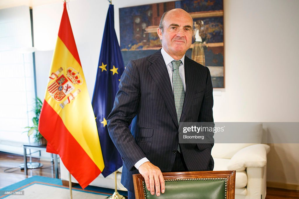 Luis de Guindos, Spain's economy minister, poses for a photograph following a Bloomberg Television interview at the economy ministry in Madrid, Spain, on Wednesday, Sept. 2, 2015. The pace of job creation in Spain lost momentum in August, adding to signs that growth in the euro area's fourth-largest economy may have peaked as the country gears up for a general election. Photographer: Angel Navarrete/Bloomberg via Getty Images