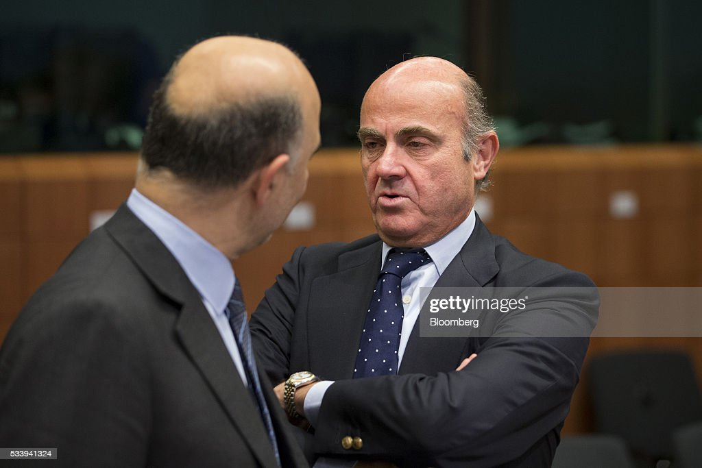 <a gi-track='captionPersonalityLinkClicked' href=/galleries/search?phrase=Luis+de+Guindos&family=editorial&specificpeople=8756055 ng-click='$event.stopPropagation()'>Luis de Guindos</a>, Spain's economy minister, right, speaks with <a gi-track='captionPersonalityLinkClicked' href=/galleries/search?phrase=Pierre+Moscovici&family=editorial&specificpeople=667029 ng-click='$event.stopPropagation()'>Pierre Moscovici</a>, economic commissioner for the European Union (EU), during a Eurogroup meeting of European finance ministers in Brussels, Belgium, on Tuesday, May 24, 2016. Five years after handing Greece the biggest sovereign-debt write-off in history, European policy makers have come full circle to the point they had all hoped to avoid: a real discussion on debt relief. Photographer: Jasper Juinen/Bloomberg via Getty Images