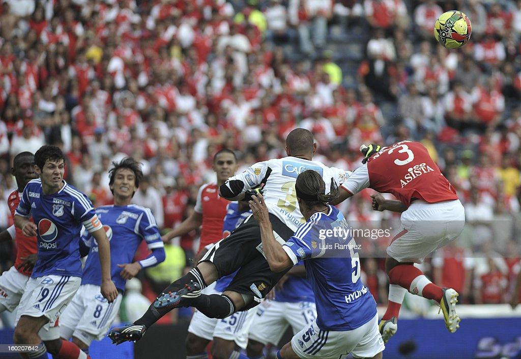 "Luis Delgado, Goalkeeper (C) of Millonarios in action during the match between Independiente Santa Fe and Millonarios as part of the the Champions Super League at Nemesio Camacho ""El Campin"" stadium on January 27, 2013 in Bogota, Colombia."