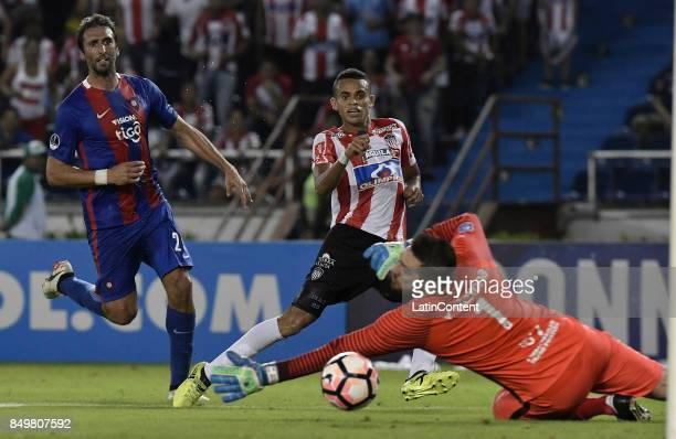 Luis Diaz Marulanda of Junior kicks to score th first goal of his team during a second leg match between Junior and Cerro Porteño as part of round of...