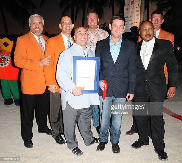 Luis E Boue Eric Poms Gary Cioffi shawn Garrity Michael Gongora Daymond John and Jeffery T Roberts attend the Ribbon Cutting Ceremony at The Orange...