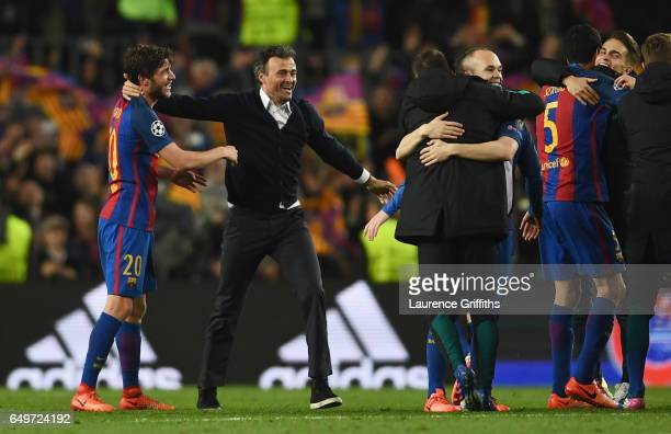 Luis Enrique manager of Barcelona celebrates victory with winning goalscorer Sergi Roberto of Barcelona after the UEFA Champions League Round of 16...